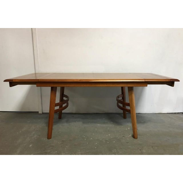 Beautifully solid dining table with a very interesting texture of smooth quarter sawn cherry wood, leaving very light...