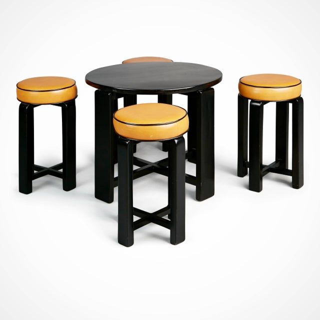 Wonderful French Art Deco set comprising of one circular occasional table and four stools. This French pub set is...