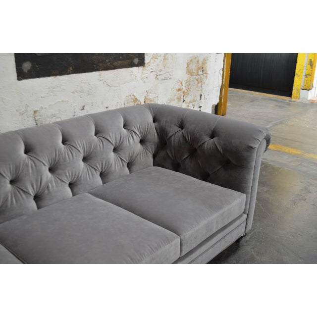 Pair of custom commercial- grade velvet Chesterfield Sofas. They were ordered for a client who no longer needed them....