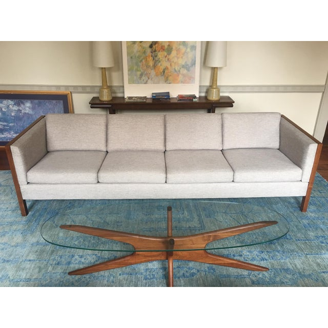 A rare four-seat long tuxedo sofa manufactured in the 1970s by Dux of Sweden. Handsome and sturdy frame in solid wood,...