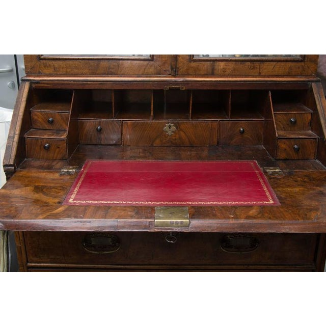 This is a spectacular early 18th century English walnut secretary or bureau cottage bookcase. The top section has a shaped...