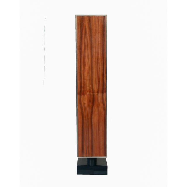 Extra large pedestal in rosewood with brass accents along the edges. Column resting in circle beam which then sits within...