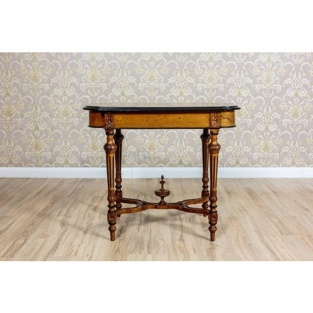 This small table is circa 1880, made in walnut wood with the table top veneered with walnut burl, and arranged in an...