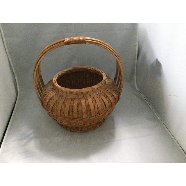 Japanese woven Susutake smoked bamboo basket with a wood handle. Bamboo willow wood.