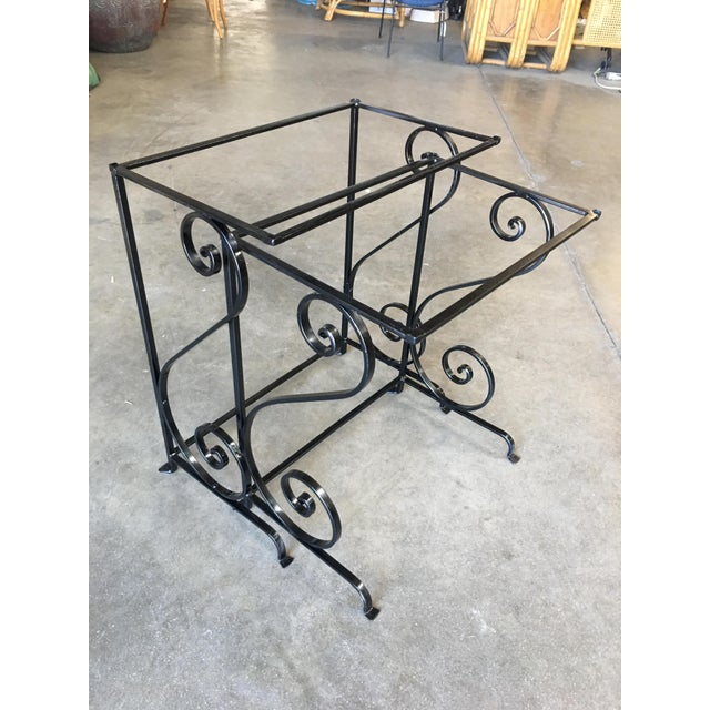 Original 1950s outdoor / patio nesting side table pair with Iron scrolling base.