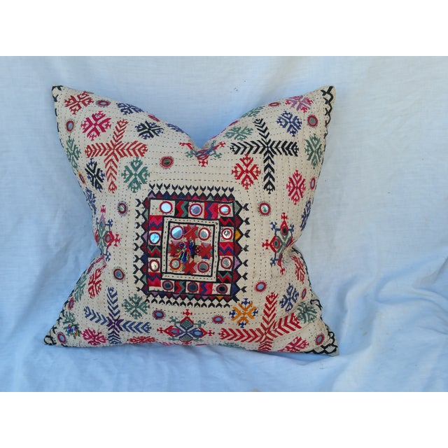 A vintage Banjara textile fragment pillow from Rajasthan, India. Linen back. Hand-loomed with an embroidered design....