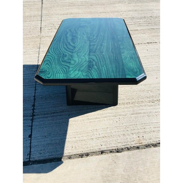 This stunning faux malachite finish coffee table is sure to be the focal point of any room. The emerald colors are a...