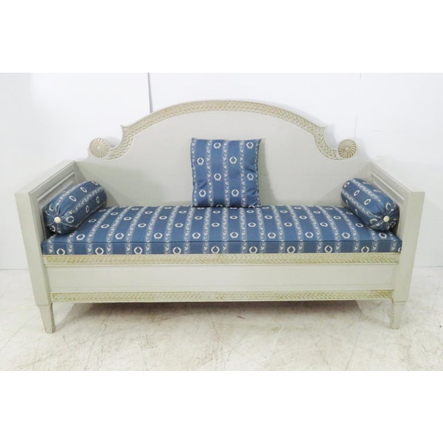 Swedish pine carved sofa with gray painted finish and gold accents, blue upholstery