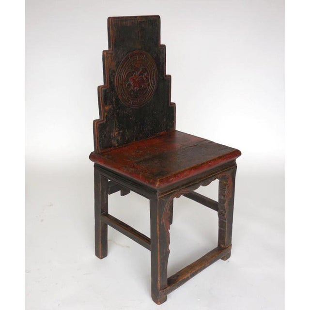 Early 19th century, all original Chinese chair with original red paint, and dragon and leaf carvings. Nice worn patina...