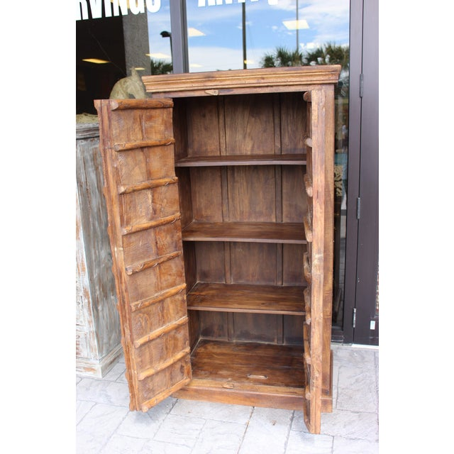 Metal Antique Indian Solid Hand Carved Wood and Iron Clad Armoire For Sale - Image 7 of 9