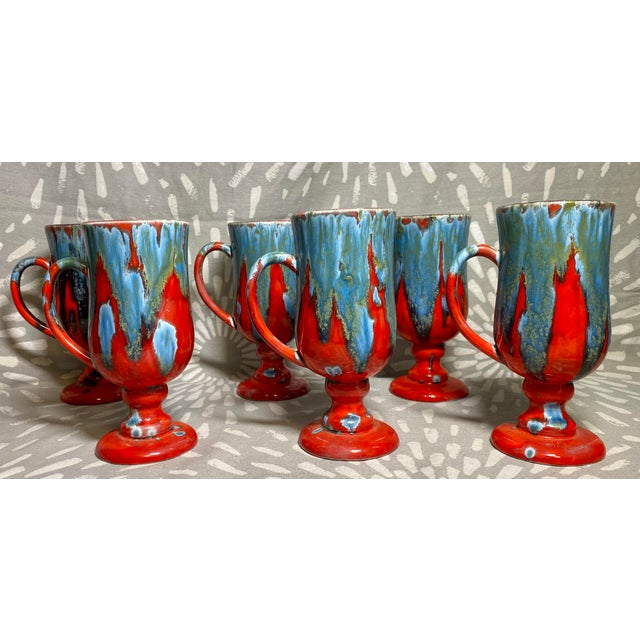 Very neat red & blue drip glaze set of six footed ceramic mug. These are hand crafted and signed with a 'B.'