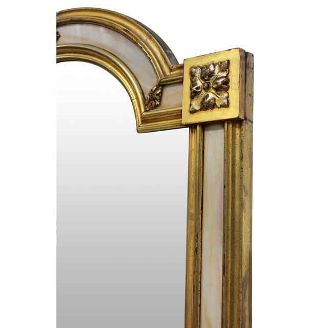 A Venetian mirror with a good water gilded frame with marble slip. The mirror plate is bevelled.