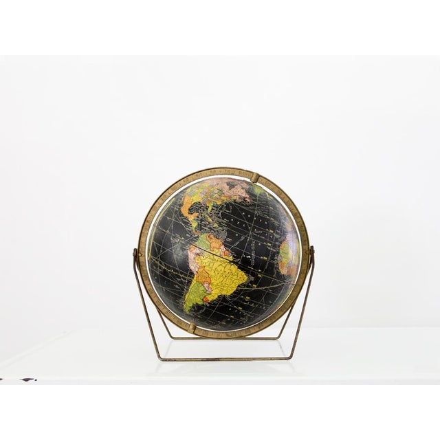 A vintage 12 inch Cram's Universal Terrestrial Globe circa 1961. The sleek modern globe feature a brass metal stand and...