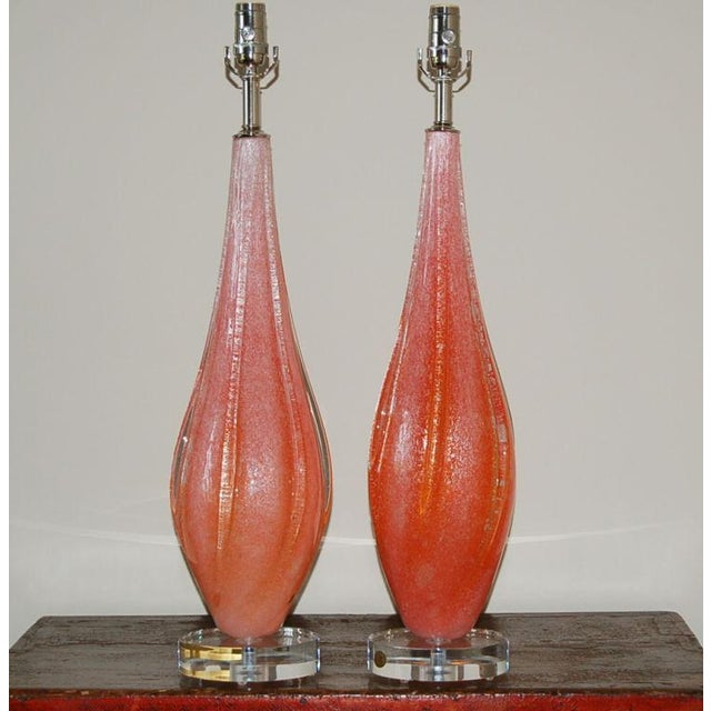 Vintage Pulegoso Murano glass table lamps, the color of RUBY RED GRAPEFRUIT. Thousands of tiny bubbles in the glass give...