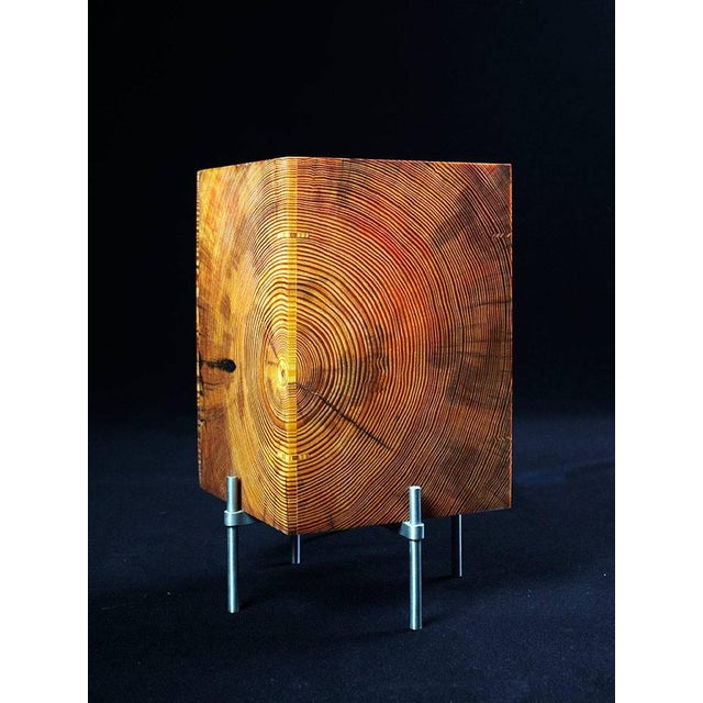 The old-growth Southern yellow pine end-grain panels that form the shades of these lamps, are naturally translucent due to...