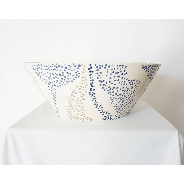 """An early production ceramic bowl by famed ceramicist Roy Hamilton in """"faux marble"""" pattern having thinly potted cream body..."""