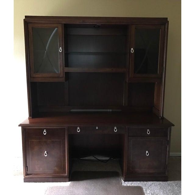Hardwood desk credenza with style & function. Features include: Burl wood doors & lap drawer Built-in adjustable desk...