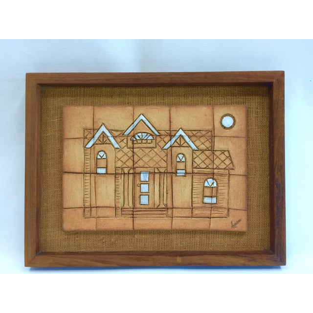 Vintage walnut framed tile art featuring a house with white glaze accents. 20 tiles mounted on a burlap covered wood...