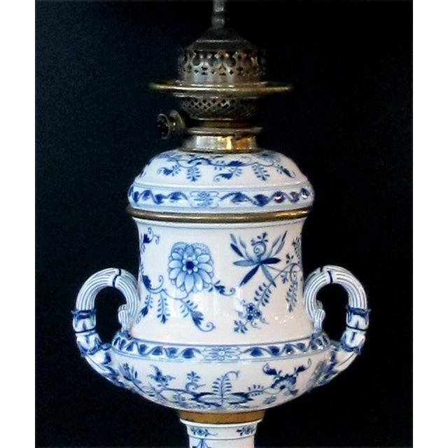 A good pair of Meissen Blue Onion pattern oil lamps now electrified; originally sold by Whiteley's Dept. Store, London;...