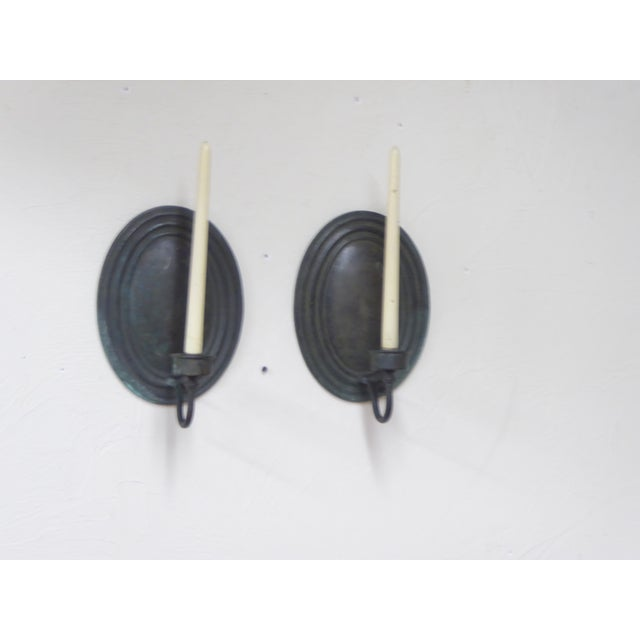 """Pair of 20th Century verdegris bronze oval sconces for candles, 12.5""""H x 7.5""""W x 7.25""""D."""