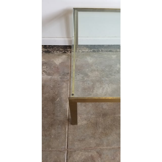 """Solid brass frame coffee table with 3/4"""" glass table top. Made in the 1970s."""