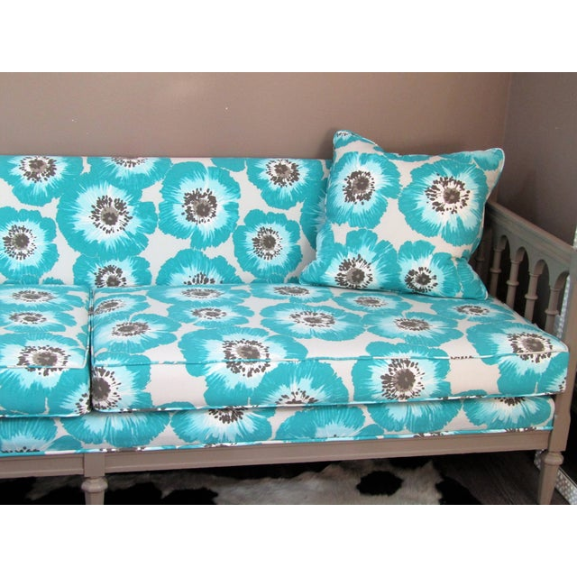 Lively, Colorful and comfortable day bed. New Upholstery fabric features large turquoise poppies with matching pillows....