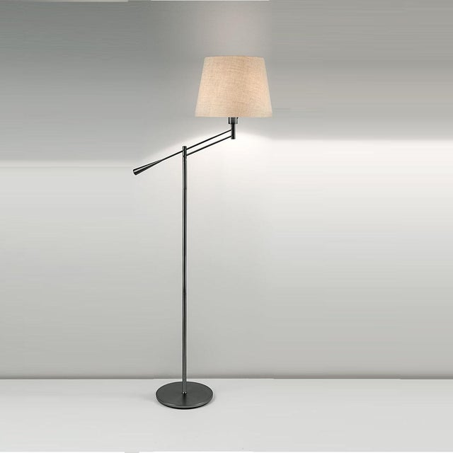 A black bronze floor light with shade. The arm can be adjusted vertically wih the shade always remaining upright. The...