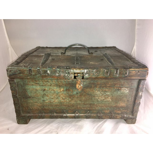 Wonderful box composed of wood and iron. Missing one hinge at the top opens fine. Lovely warmer patina