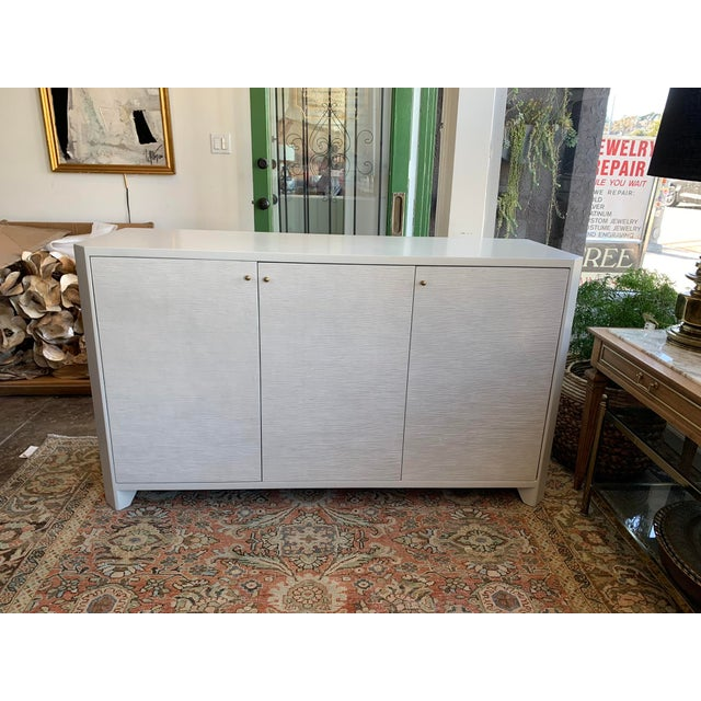 Bring some functional elegance to your dining or living space with this Alcott buffet cabinet from Made Goods. This model...