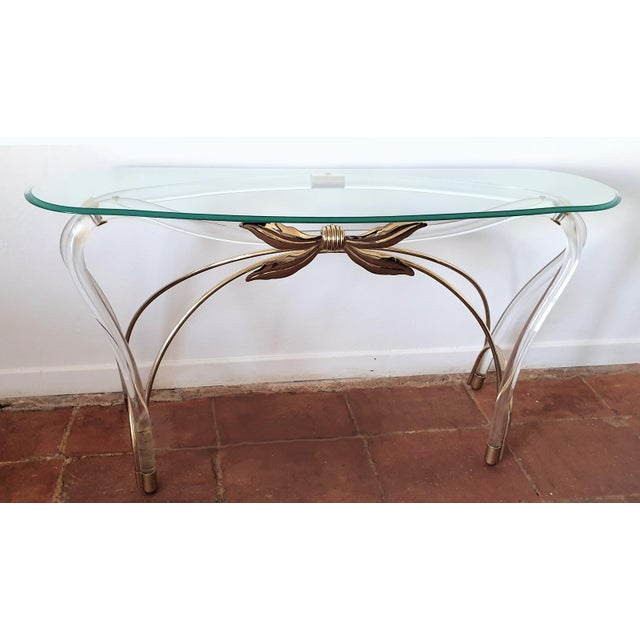 Large Mid-Century Modern console table, with organic design and shape, Spain, 1970s. Made of glass beveled top, brass and...