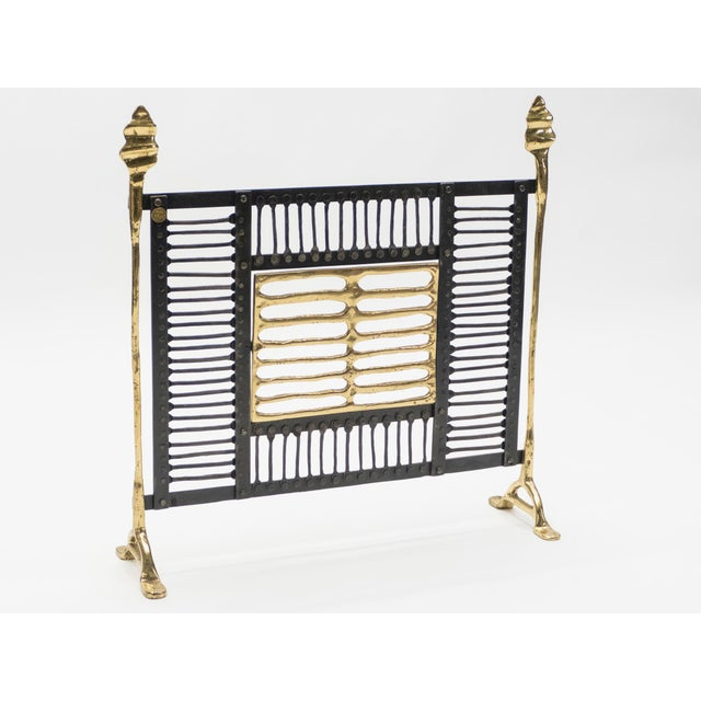 Garouste and Bonetti are known for their experimental and highly artistic designs, this fire screen, with its iron and...