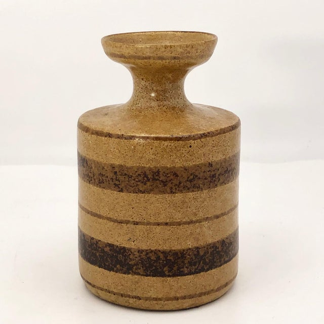 This is a nice Pottery Craft stoneware bud vase circa 1960s, just the right size for one big bloom. Quintessentially mid-...