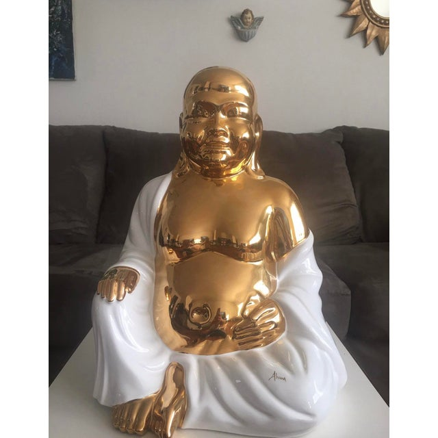 This large porcelain statue is hand painted in a high gloss white and 24kt gold. This piece is sure to bring tranquility...