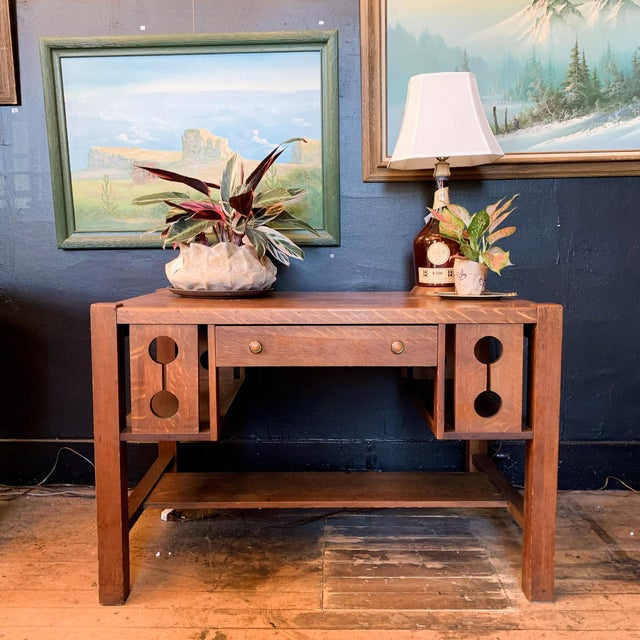 Made in the 1930s. Solid wood craftsman desk with side storage and one drawer at the front.
