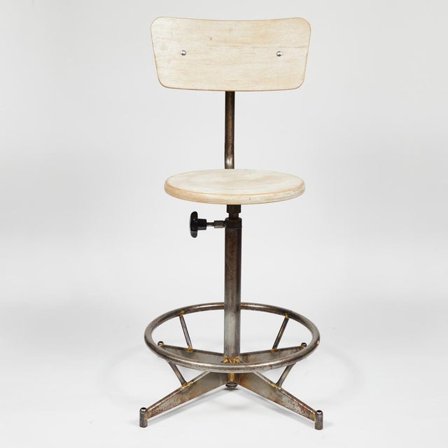 A light wood and metal adjustable swivel high chair. Can be sold individually ($975 each) or as group (six available).