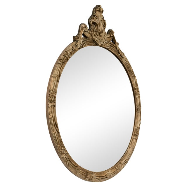 "Mid-20th C. circular carved gilded mirror with protruding ornate acanthus crest. The 1.75"" wide frame depicts a running..."