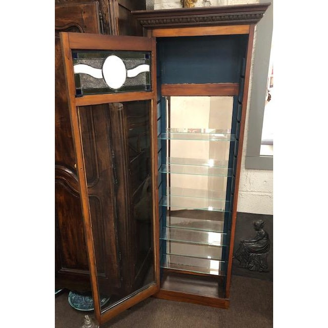 This is an antique perfume cabinet with a stained & leaded glass top. One door with multiple adjustable glass shelves....