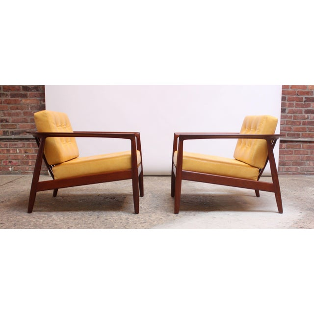 Folke Ohlsson for Dux of Sweden sculptural staved-teak lounge chairs (Model 72-C) featuring a rounded / slatted back and...