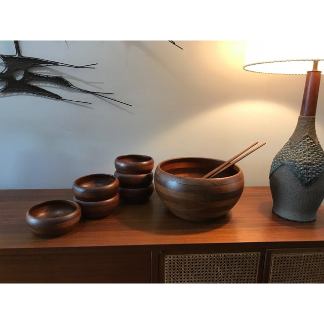 Amazing 9 piece set of Illums Bolighus for Wiggers of Denmark staved teak salad bowls and servers. Small bowls are all in...