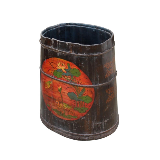 This is a handmade Chinese accent decorative bucket / wood container in a barrel shape. The body is finished with uneven...