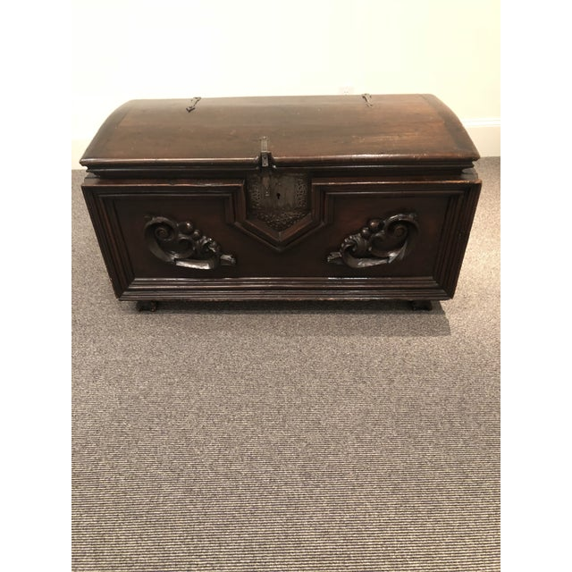 Antique Italian chest, intricately carved with pewter hardware. Made in the 20th century.