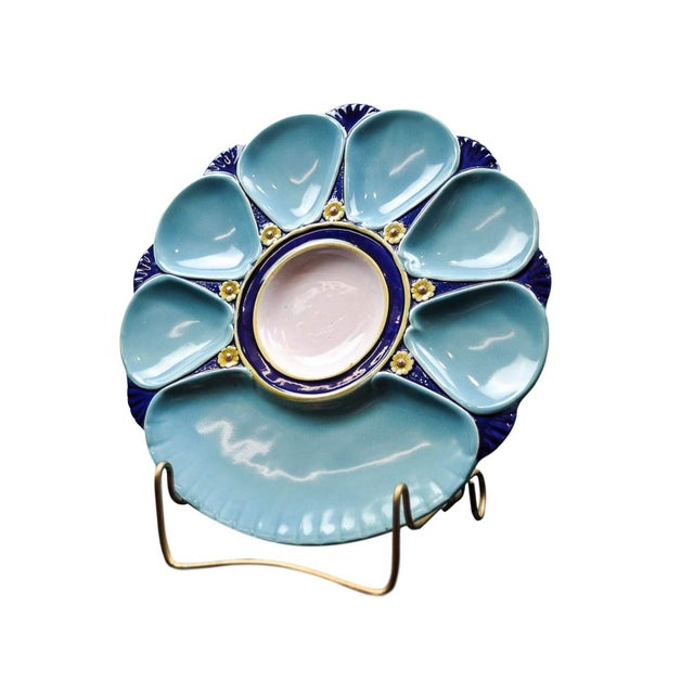 A Minton Majolica Oyster plate with a central well glazed in pink and encircled by a band glazed in cobalt blue surrounded...
