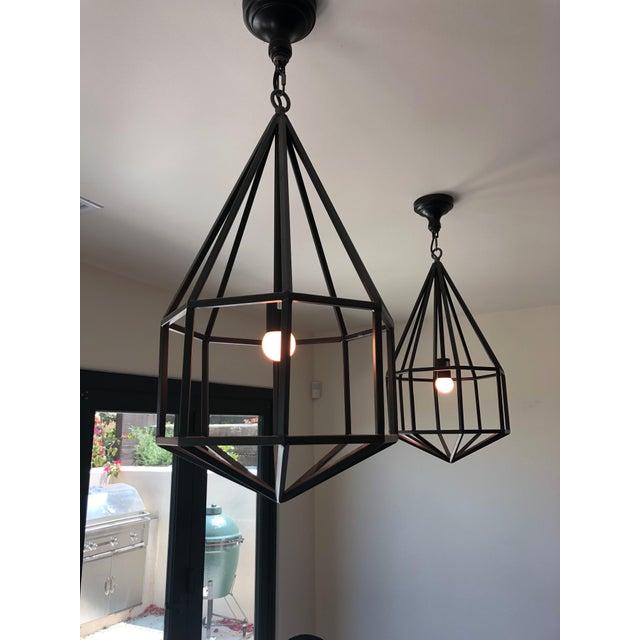 "Iron ""look"" (metal), teardrop-shaped, modern lanterns. No glass. Single Edison socket, 25 max watt each. Round canopy with..."