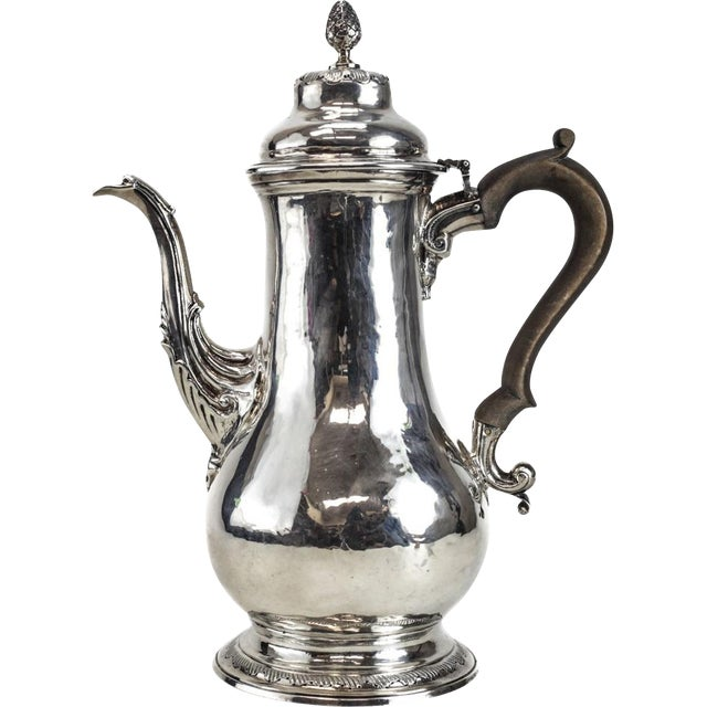 Charles Wright London George III sterling silver coffee pot, 1769. The coffee pot has a wooden handle and an acorn finial....