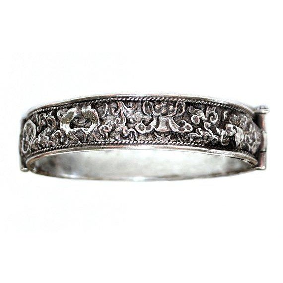 C.1890s to 1910s Chinese sterling hinged bangle with a screw clasp closure. Unsigned but tests as sterling and is...