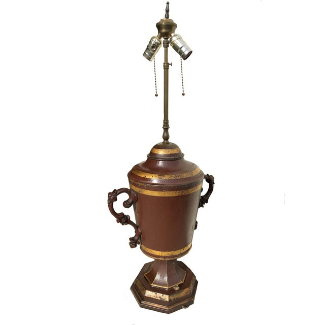 A stunning and unusual tole lamp, fashioned from what is likely an old tavern dispenser, although I'm not certain. Early...