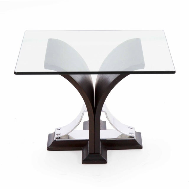 An interesting table from the second quarter of the 20th century with an ebonized oak veneer steam bent into a sprouted...