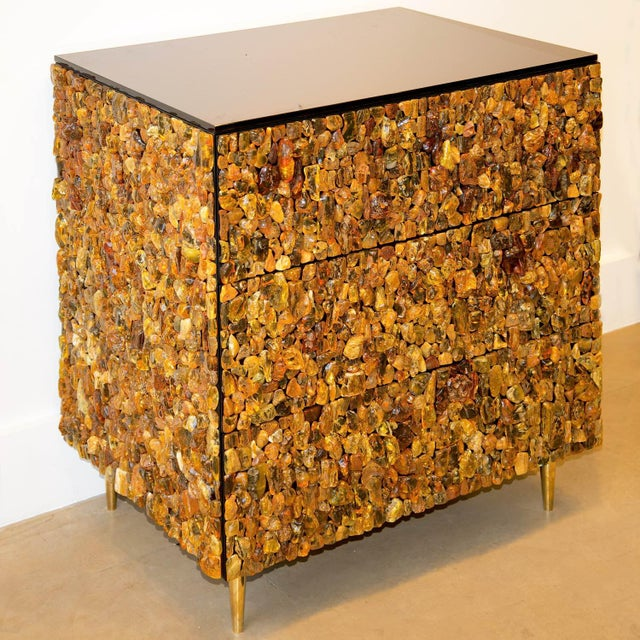 KAM TIN Amber chest of drawers Natural amber, wood, brass, tinted glass This chest has 3 drawers, and the top plate is in...