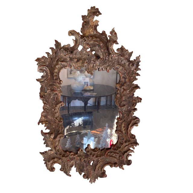 A wonderfully hand carved and gessoed mirror 19th century mirror from France.