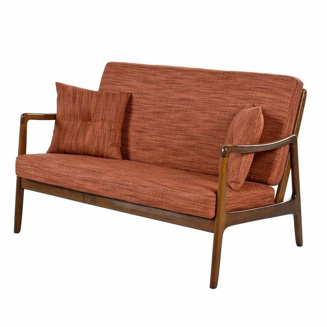 We are pleased to present this rare Danish settee by Ole Wanscher for Fance & Daverkosen. Collectors will recognize these...